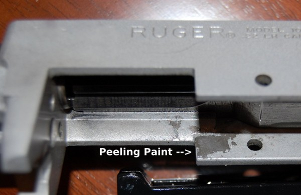 Peeling paint on stainless Ruger 10/22 rifle